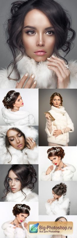 Christmas beautiful girl in white fur clothes with a hood