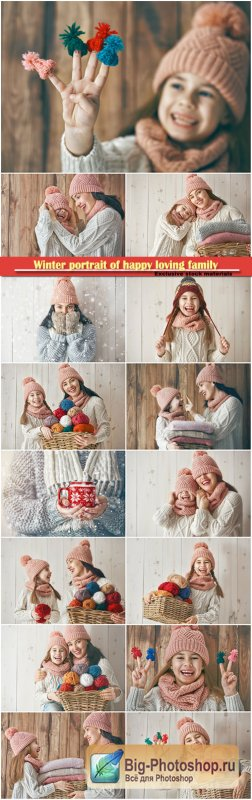Winter portrait of happy loving family wearing knitted hats and sweaters